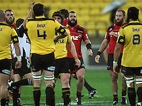 Referee Chris Pollock awards a scrum penalty to the Hurricanes as Crusaders front rowers Oen Franks (left), Corey Flynn (centre) and Ben Franks retreat. Super 15 rugby match - Crusaders v Hurricanes at Westpac Stadium, Wellington, New Zealand on Saturday, 18 June 2011. Photo: Dave Lintott / lintottphoto.co.nz