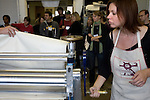 "O.U. student Annette Gasper rolls a press during the 2006 Mid America Print Council conference ""Forging Connections"" at Ohio University on Friday, 9/22/06. The conference runs from September 20-23. Around 700 printmakers, students, curators and other art professionals are expected to attend the biennial event."