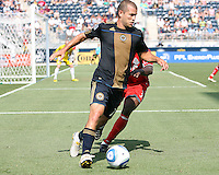 Alejandro Moreno #15 of the Philadelphia Union turns away from Nana Attakora #3 of Toronto FC during an MLS match at PPL stadium in Chester, PA. on July 17 2010. Union won 2-1 with a last minute penalty kick goal.