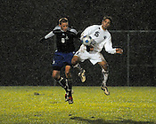 The rain was falling steadily at the sectional semi-final at Brookfield East High School as Brookfield Central's Nate Rohde (left) and East's Adam Knudsen go after the ball on Thursday, Oct. 22, 2009. Ernie Mastroianni photo.
