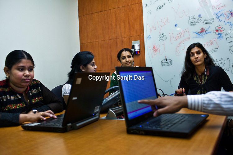Team members attend an advisory meeting at the Ernst & Young Global Shared Services office in Bangalore, Karnataka, India. Ernst & Young has 49% women working for them in the India office. Photo: Sanjit Das