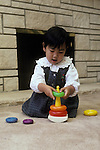 Palo Alto CA, Girl (Japanese), two and a half-years-old, mastering graduated shape toy  MR