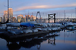 Dinghies and small craft stored on marina with the background of highrise apartments and offices against the background of Granville bridge in Vancouver.  British Columbia, Canada