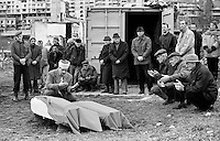 Mourners of several religions at the improvised funeral of two Muslims in the besieged Bosnian capital Sarajevo on December 9, 1993. Funerals can often not take place in the regular cemeteries due to incoming sniper and artillery fire.