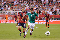 Carlos Salcido (3) of Mexico shields Landon Donovan (10) of the United States from the ball. The men's national teams of the United States (USA) and Mexico (MEX) played to a 1-1 tie during an international friendly at Lincoln Financial Field in Philadelphia, PA, on August 10, 2011.