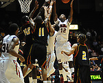 "Ole Miss' Maurice Aniefiok (12) vs. Grambling State's Bryant Purvis (11) during the first half at the C.M. ""Tad"" Smith Coliseum in Oxford, Miss. on Monday, November 14, 2011.."