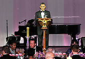 U.S. President Barack Obama (C) proposes a toast as he and first lady Michelle Obama host British Prime Minister David Cameron (2nd L) and his wife Samantha Cameron (R) for a state dinner at the South Lawn of the White House March 14, 2012 in Washington, DC. Prime Minister Cameron was on a three-day visit in the U.S. and he had talks with President Obama earlier the day.  .Credit: Alex Wong / Pool via CNP