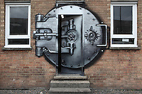 Huntingdon Estate buidling door with spray paint mural depicting a submarine access door, Bethnal Green Road, London, UK. Picture by Manuel Cohen