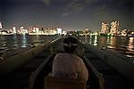 "Aihiro Yasuda steers one of Harumiya Co.'s ""yakata-bune"" pleasure boats toward central Tokyo, Japan on 30 August  2010. .Photographer: Robert Gilhooly"