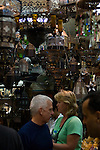 Khan el-Khalili bazaar, Cairo, Egypt -- A few patrons is a crowd a very small lamp and metal goods shop in the Khan bazaar.  (Subject permission / release is available.) © Rick Collier / RickCollier.com.