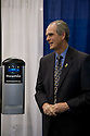 Chuck Reed, Mayor of San Jose, announces new smart charging stations infrastructure for plug-in vehicles through a partnership with Coulomb Technologies. Coulomb's ChargePoint charging stations will be attached to streetlight poles and other access points. Secure charging access can be purchased by plug-in vehicle drivers. Coulomb's ChargePoint Network includes public charging stations, a consumer subscription plan, and utility grid management technology. Opening day of the July 22-24 inaugural Plug-In 2008 Conference & Exposition: A Short Drive to Tomorrow in San Jose, CA. The event showcases the latest technological advances, market research and policy initiatives shaping the future of plug-in hybrid electric vehicles (PHEVs). Original photo is high-resolution (4368 x 2912 pixels).