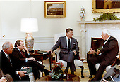 """United States President Ronald Reagan, right center, meets with U.S. House Speaker Thomas P. """"Tip"""" O'Neill, Jr. (Democrat of Massachusetts), right, U.S. Senate Majority Leader Howard H. Baker, Jr. (Republican of Tennessee), left center, and U.S. House Minority Leader Robert H. """"Bob"""" Michel (Republican of Illinois), left, in the Oval Office of the White House in Washington, D.C. on Monday, January 31,1983 to discuss the President's proposed budget for Fiscal Year 1984..Mandatory Credit: Jack Kightlinger - White House via CNP"""