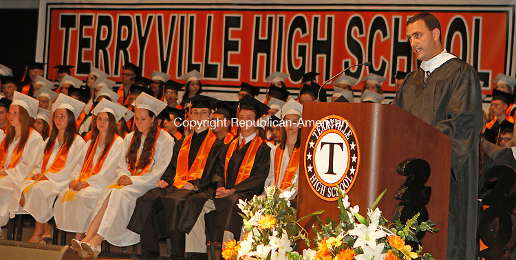 Terryville, CT-061814MK02 Principal Brian Falcone addresses the seniors of the Terryville High School's class 2014 during commencement exercises on Wednesday evening.  Falcone has followed this class as a school administrator from when the Terryville students were in sixth grade.  One-hundred and nineteen graduates received diplomas. Michael Kabelka / Republican-American