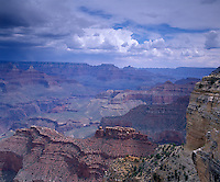 Grand Canyon National Park, AZ<br /> View of The Battleship Butte and Grand Canyon under approaching storm clouds - from Hopi Point