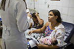 RECIFE, BRAZIL - JANUARY 8: Cleane Serpa, 18, holds her one-month-old cousin, Maria Eduarda, who was born with microcephaly, receives her hospital check-out paperwork at the Hospital Universit&aacute;rio Oswaldo Cruz, in Pernambuco's capital of Recife, in Brazil, on Friday, Jan. 8, 2016. The parents of Maria Eduardo, who are extremely poor, did not want her so Cleane and an aunt will raise the baby.<br /> <br /> The mosquito-borne Zika virus continues to spread in Brazil, alarming health officials and expecting mothers that their babies will be born with abnormal brain development called microcephaly. While researchers have yet to make a connection, Brazil has the highest number of babies born with mircocephaly - the most cases in Recife, Pernambuco - from mothers who tested positive to the Zika virus. There are about 3,530 suspected cases of zika-related microcephaly in Brazil.