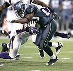 Seattle Seahawks running back Justin Forsett is tackled by Minnesota Vikings cornerback Antoine Winfield at CenturyLink Field in Seattle, Washington August 20, 2011. The Vikings beat the Seahawks  20-7. ©2011 Jim Bryant Photo. All Rights Reserved.