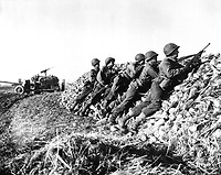 A U.S. Infantry anti-tank crew fires on Nazis who machine-gunned their vehicle, somewhere in Holland.  November 4, 1944.  W. F. Stickle.  (Army)<br /> NARA FILE #:  111-SC-197367<br /> WAR &amp; CONFLICT BOOK #:  1068