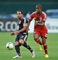 Dwayne De Rosario (22) of D.C. United goes against Alan Rochat (25) of Toronto FC. Toronto FC defeated D.C. United 2-1, at RFK Stadium, Saturday June 15 , 2013.