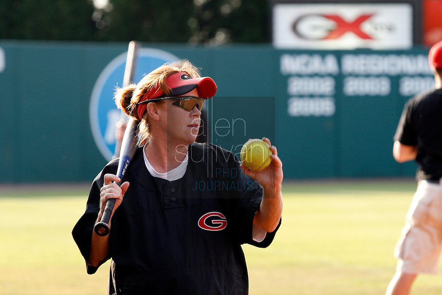 UGA softball coach and mother of two Lu Harris-Champer hits grounders to the team during practice in Athens, Ga. on Wednesday, May 27, 2006. She is due to give birth to another daughter next week. Her husband, Jerry Champer, is an assistant coach for the UGA swimming team.