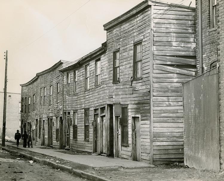 1953 December..Historical..Slum Conditions..Neal Clark Jr..NEG#.NRHA# 558..