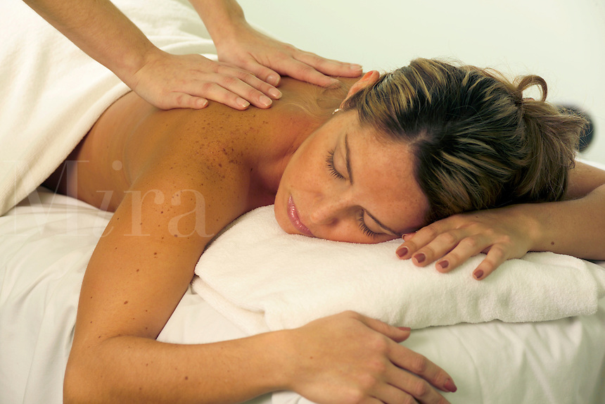 Young female receiving massage.