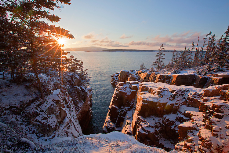 View of Cadillac Mountain across Frenchman Bay from the Raven's Nest in winter on the Schoodic Peninsula at Acadia National Park, Maine, USA