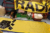 Motoko Tatsumi painting banners on board the Greenpeace ship Rainbow Warrior, as it transits northwards to Fukushima, Japan, on Monday 25th April 2011.