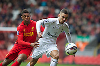 LIVERPOOL, ENGLAND - Easter Monday, April 1, 2013: Liverpool's Jordan Ibe in action against Tottenham Hotspur's Ryan Fredericks during the Under 21 FA Premier League match at Anfield. (Pic by David Rawcliffe/Propaganda)