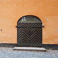 Wooden door on building, Gamla Stan - old town, Stockholm, Sweden
