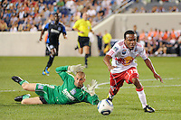 Dane Richards (19) of the New York Red Bulls stumbles after getting past San Jose Earthquakes goalkeeper Jon Busch (18). The New York Red Bulls defeated the San Jose Earthquakes 2-0 during a Major League Soccer (MLS) match at Red Bull Arena in Harrison, NJ, on August 28, 2010.