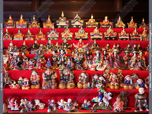 Set of Japanese ornamental Hina dolls representing the Emperor, Empress, attendants, and musicians in traditional court dress of the Heian period. Gero, Gifu, Japan.