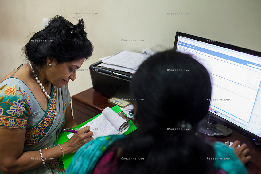 Dr. Nayana Patel, dictates her email answers to her assistant in her Akanksha IVF and surrogacy center in Anand, Gujarat, India on 10th December 2012. Surrogacy clients pour into Anand from across the world pursuing Dr Patel's expertise on the process, and they keep in touch with her and the progress of the pregnancies via the internet and phone. While 15% of couples are infertile globally, only 6% of infertility cases require surrogacy as a last option. Photo by Suzanne Lee / Marie-Claire France