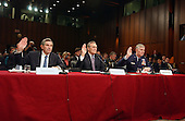 Washington, D.C. - March 23, 2004 -- United States Secretary of Defense Donald H. Rumsfeld, center, is sworn-in to testify before The National Commission on Terrorist Attacks Upon the United States (also known as the 9-11 Commission) in Washington, D.C. on March 23, 2004.  Deputy Secretary of Defense Paul Wolfowitz, left, and the Chairman of the Joint Chiefs of Staff, General Richard Myers, right, are sworn in as well.<br /> Credit: Ron Sachs / CNP<br /> [RESTRICTION: No New York Metro or other Newspapers within a 75 mile radius of New York City]