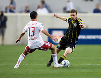 Eddie Gaven (12) of the Columbus Crew fights for the ball with Austin Da Luz (13) of the New York Red Bulls during the game at Red Bull Arena in Harrison, NJ.  The New York Red Bulls tied the Columbus Crew, 1-1.