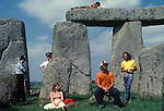 1970's style hippies attend the first free festival at Stonehenge to celebrate the summer solstice June 21st 1975 Besides the hippies a small group of tourists came to watch the celebrations over the three day festival.