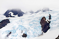 The Blue Glacier on Mt. Olympus, seen from the lateral moraine. The Hoh River trail in Olympic National Park starts in the mossy and lush Hoh Rain Forest. From there you climb over 5,000 ft. in elevation along towering trees and rock to overlook the windswept Blue Glacier on Mt. Olympus. Tracing your steps back to the Hoh River visitors center the hike covers over 36 miles of diverse climate and ecosystems ranging from temperate rain forest to alpine.