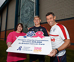 Martyn Waghorn and Pedro Caixinha lend support to Kirsty Wightman from Breast Cancer Care Scotland with a £25k donation from the Rangers Charity Foundation