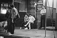 May, 1980. Manhattan, New York City, NY. Prostitution, drugs and pornography are everywhere in the streets. A transvestite prostitute displays his wares on a Times Square street.. By 1980 Times Square had become a beehive of prostitution activity. And dealers are in each doorway.<br /> <br /> Manhattan, New York City, NY, Mai, 1980. La prostitution, la drogue, la pornographie et les fous rendent le quartier tr&egrave;s dangereux.<br /> 3 heures du matin : Times Square et les rues avoisinantes sont maintenant la proie de la prostitution agressive des homosexuels et des travestis et des vendeurs de drogues se placent dans chaque recoin obscure.