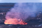 Hawai'i Volcanoes National Park, Big Island of Hawaii, Hawaii; the glow of the lava lake, several hundred feet beneath the rim of the Halemaʻumaʻu crater on Kīlauea volcano,  is visible at twilight