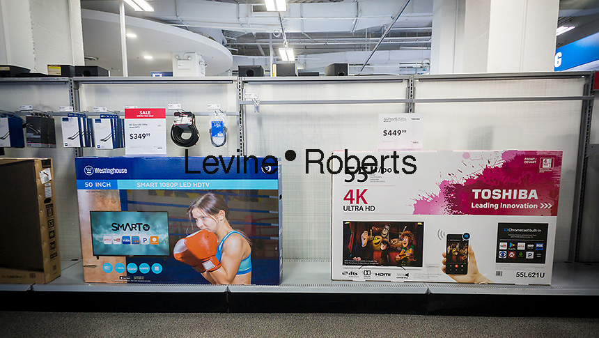 Boxes of Toshiba brand flat-screen televisions in a Best Buy store in New York on Tuesday, April 11, 2017. Toshiba announced that losses associated with its nuclear power subsidiary, Westinghouse Electric, may be so great as to prevent the company from continuing. The Westinghouse television is not related to Toshiba and is produced by another company under license. (© Richard B. Levine)