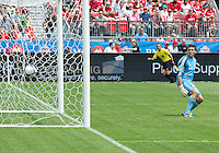 29 June 2013:Toronto FC goalkeeper Joe Bendik #12 can only watch as a shot from Real Salt Lake midfielder Yordany Alvarez #14 finds the back of the net during an MLS game between Real Salt Lake and Toronto FC at BMO Field in Toronto, Ontario Canada.<br /> Real Salt Lake won 1-0.