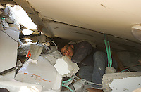 Al Zaytoun, Gaza. Ahmed Selmi, searches to rescue some goods from the rubble from what once was his bedroom on his family house in the neighborhood of Al Zaytoun in the outskirts of Gaza city. The Selmis, a family of five made their living farming vegetables for the local markets. (PHOTO: MIGUEL JUAREZ LUGO)
