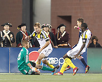 Columbus Crew goalkeeper Matt Lampson (28) save. In a Major League Soccer (MLS) match, the New England Revolution (blue) defeated Columbus Crew (white), 3-2, at Gillette Stadium on October 19, 2013.
