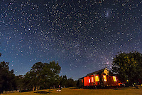 Sirius, Canopus and the southern Milky Way over Timor Cottage at Coonabarbran, NSW, Australia, December 18, 2012. The LMC is above right. Taken in moonlight from waxing crescent Moon. A single 75-second exposure with Canon 60Da at ISO 1600 and 10-22mm lens at f/4.