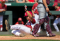 NWA Democrat-Gazette/JASON IVESTER<br /> Arkansas' Jordan McFarland slides past Mississippi State catcher Dustin Skelton Sunday, March 19, 2017, for a run at Baum Stadium in Fayetteville.