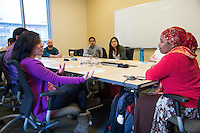 Bisharo Kasim, a Somali Bantu and interpreter, (in red sweater) meets with medical students - Katia Chavez, left.