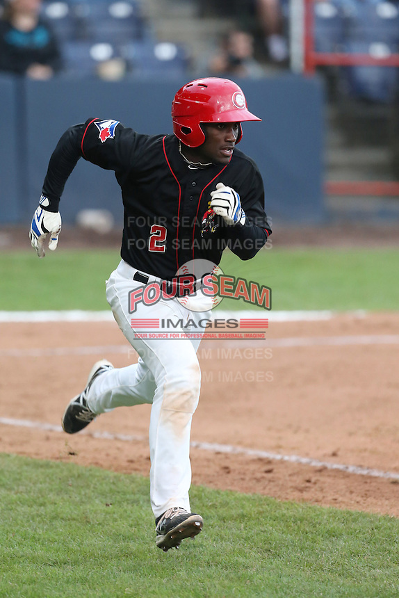 Roemon Fields #2 of the Vancouver Canadians runs to first base during a game against the Hillsboro Hops at Nat Bailey Stadium on July 24, 2014 in Vancouver, British Columbia. Vancouver defeated Hillsboro, 5-2. (Larry Goren/Four Seam Images)