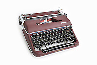 Olympia SM4 portable typewriter. Serial Number 1309237. Colour: Burgundy maroon crackelure matt finish crackle paint. Manufactured: Olympia Werke AG. Wilhelmshaven, West Germany 1958