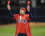 A Mississippi fan waves maracas during a promotional event at Oxford-University Stadium on Friday, March 26, 2010 in Oxford, Miss. Ole Miss won 3-2.