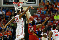 Ohio State Buckeyes center Amir Williams (23) blocks a shot by Dayton Flyers guard Vee Sanford (43) in the second half of the second-round NCAA Tournament game between the Ohio State Buckeyes and the Dayton Flyers at the First Niagara Center, Thursday afternoon, March 20, 2014. The Dayton Flyers defeated the Ohio State Buckeyes 60 - 59. (The Columbus Dispatch / Eamon Queeney)